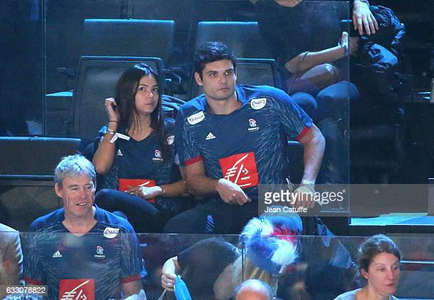 Florent Manaudou and Ambre Baker attend the 25th IHF Men's World Championship 2017 Final between France and Norway at Accorhotels Arena on January 29...