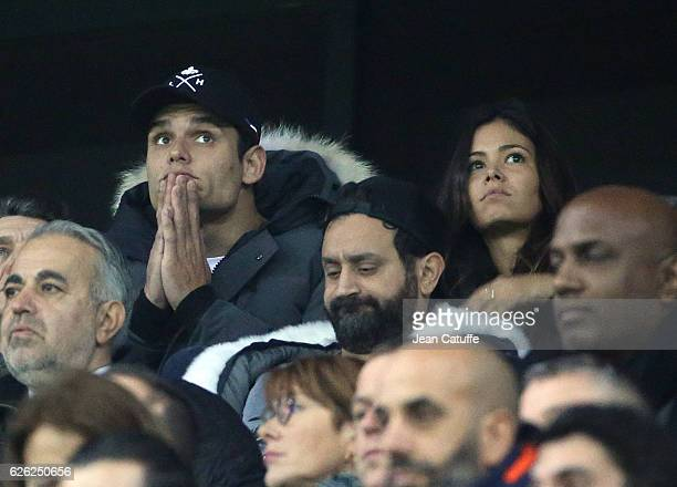 Florent Manaudou and Ambre Baker below Cyril Hanouna attend the French Ligue 1 match between Olympique Lyonnais and Paris SaintGermain at Parc OL...
