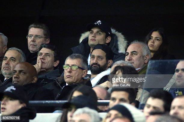 Florent Manaudou and Ambre Baker below Marc Lavoine Cyril Hanouna attend the French Ligue 1 match between Olympique Lyonnais and Paris SaintGermain...