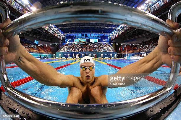 Florent Manaudou of France competes in the Men's 50m Backstroke heats on day three of the 12th FINA World Swimming Championships at the Hamad Aquatic...
