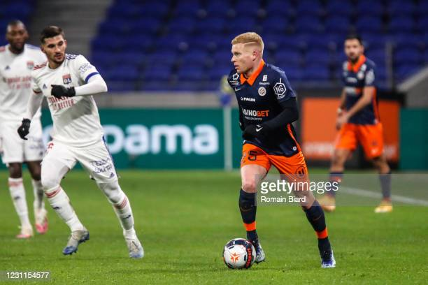 Florent MOLLET of Montpellier and Houssem AOUAR of Lyon during the Ligue 1 match between Olympique Lyon and Montpellier HSC at Groupama Stadium on...