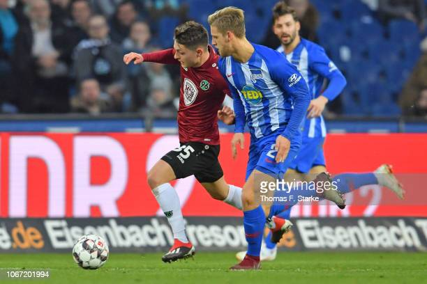 Florent Muslija of Hannover and Arne Maier of Berlin fight for the ball during the Bundesliga match between Hannover 96 and Hertha BSC at HDIArena on...
