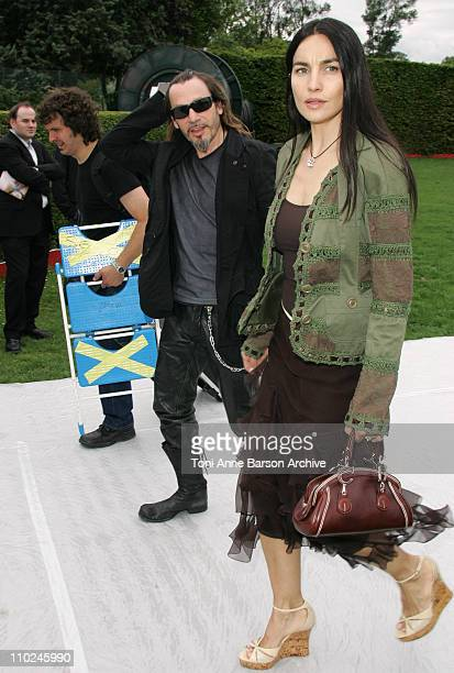 Florent Pagny and Wife during Paris Haute Couture Fashion Week - Fall/Winter 2005 - Christian Dior - Arrivals at Polo de Paris in Paris, France.