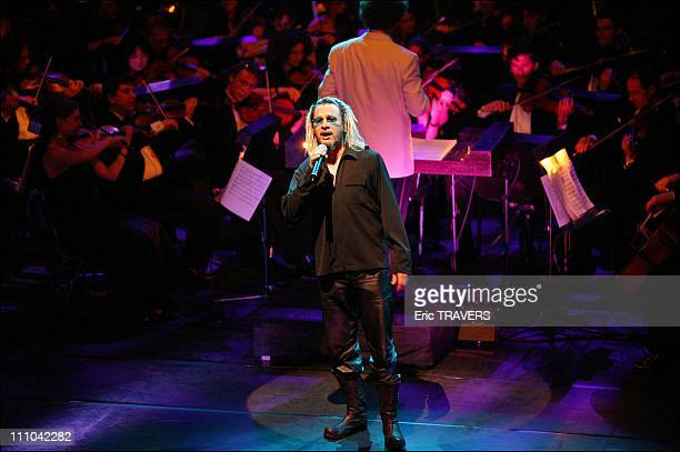 Florent Pagny with il Novecento orchestra conducted by Robert Groslot with the Fine Fleur choir in Night of the Proms at the Olympia in Paris France...