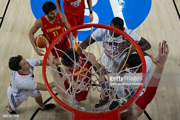 Florent Pietrus of France grabs the neck of Sergio Llull of Spain during the 2014 FIBA World Basketball Championship quarter final match between...