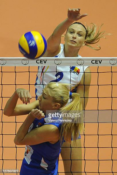 Florentina Nedelcu of Romania smashes as Ana Antonijevic of Serbia blocks during the women's Volleyball European Championship match between Serbia...