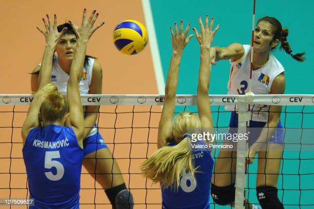 Florentina Nedelcu of Romania smashes as Natasha Krsmanovic and Ana Antonijevic of Serbia block during the women's Volleyball European Championship...