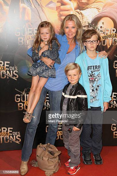 Florentine Leconte and her children MarieLou Jules and Ulysse attend the 'La Nouvelle Guerre Des Boutons' premiere at Cinema Gaumont Opera on...