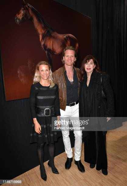 Florentine Rosemeyer Mike Kraus and Anja Kruse attend the Veneration exhibition opening in cooperation with photographer Mike Kraus on May 16 2019 in...
