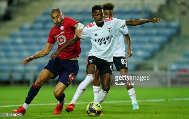 Florentino Luis of SL Benfica with Burak Yilmaz of LOSC Lille in action during the Pre-Season Friendly match between SL Benfica and Lille at Estadio...