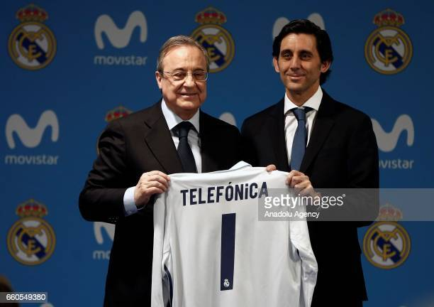 Florentino Perez President of Real Madrid CF and Jose Maria AlvarezPallete Chairman and CEO of Telefonica SA hold a Real Madrid shirt after...
