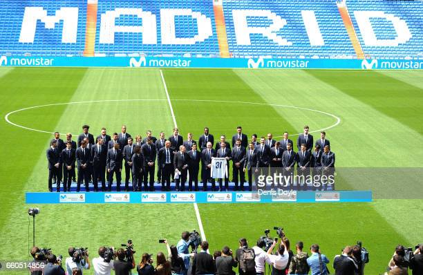 Florentino Perez President of Real Madrid CF Jose Maria AlvarezPallete Chairman and CEO of Telefonica SA pose with Real Madrid football and...