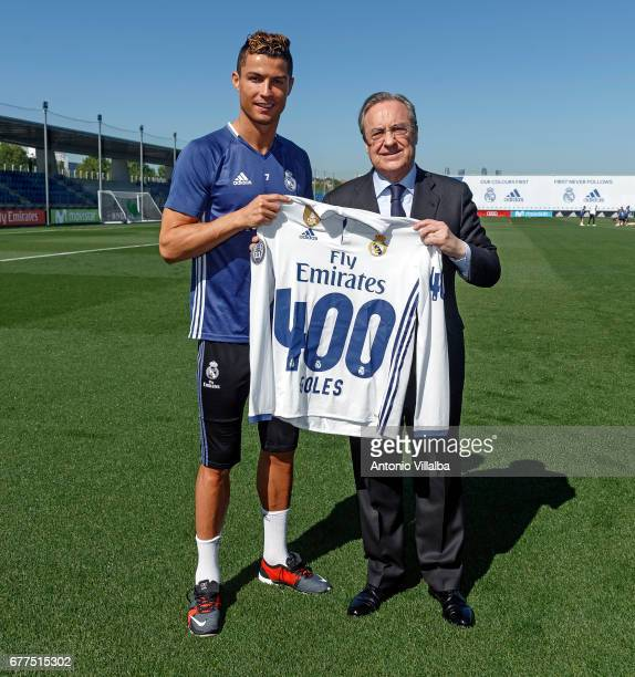 Florentino Perez President of Real Madrid hands a shirt to Cristiano Ronaldo to mark him reaching 400 goals at Valdebebas training ground on May 3...