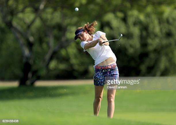 Florentyna Parker of England plays her second shot on the ninth hole during the completion of the first round of the 2016 Omega Dubai Ladies Masters...