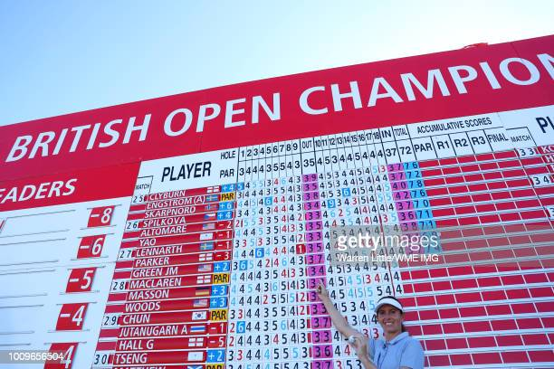 Florentyna Parker of England poses in front of the leaderboard after her hole in one on the 9th hole during the first round of the Ricoh Women's...