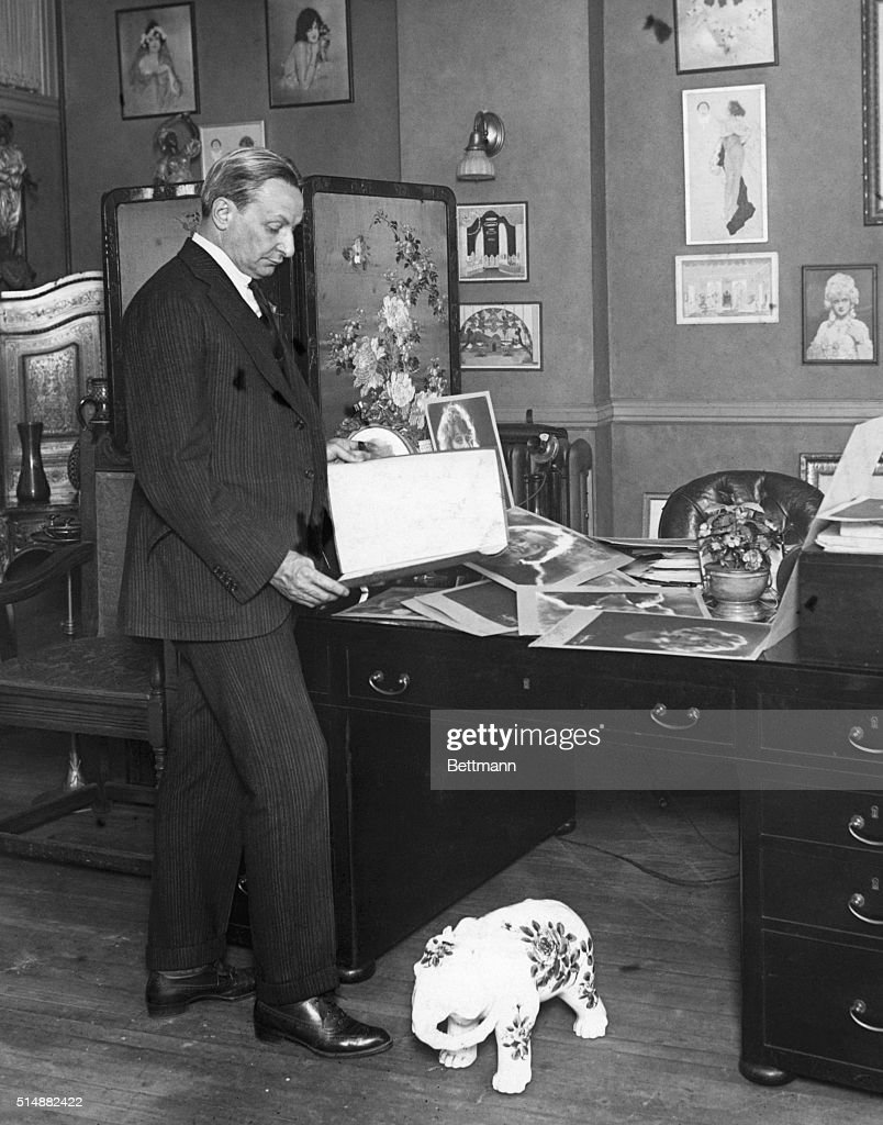 Florenz Ziegfeld Looking At Photographs : News Photo
