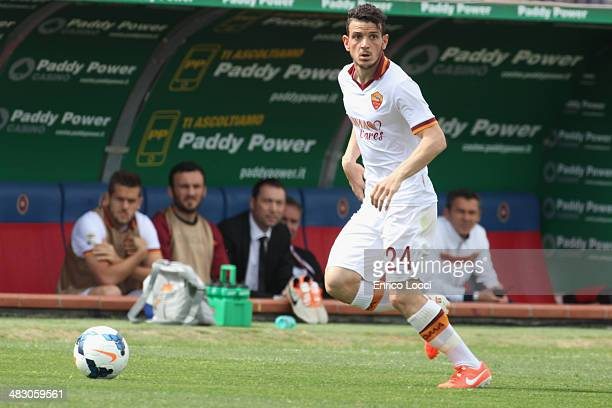 Florenzi Alessandro of Roma in action during the Serie A match between Cagliari Calcio and AS Roma at Stadio Sant'Elia on April 6 2014 in Cagliari...