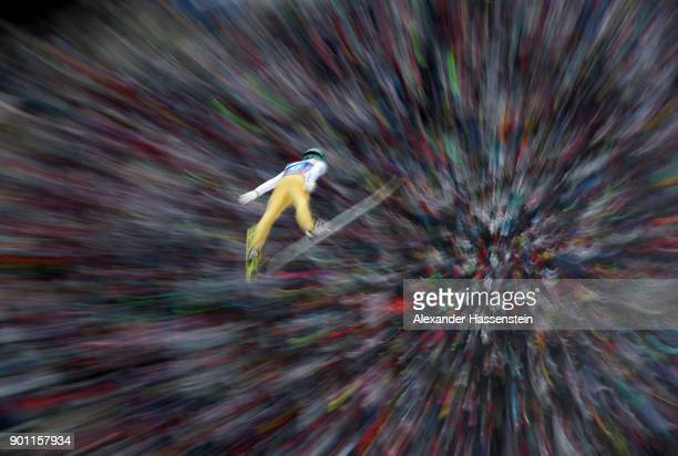 Florian Altenburger of Austria soars through the air during his competetion jump of the 65th Four Hills Tournament at Bergisl Schanze on January 4...
