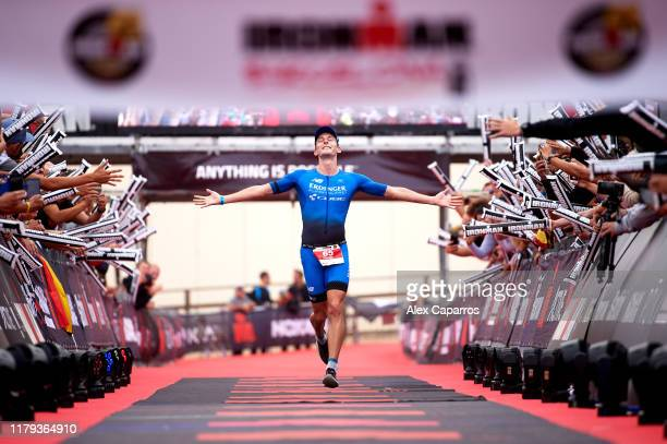 Florian Angert of Germany celebrates his victory on the men's race of IRONMAN Barcelona on October 06, 2019 in Barcelona, Spain.