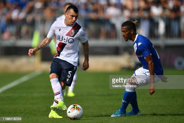 Florian Aye of Brescia Calcio competes with Gary Medel of Bologna FC during the Serie A match between Brescia Calcio and Bologna FC at Stadio Mario...