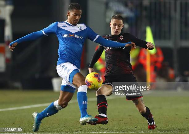 Florian Aye of Brescia Calcio is challenged by Andrea Conti of AC Milan during the Serie A match between Brescia Calcio and AC Milan at Stadio Mario...