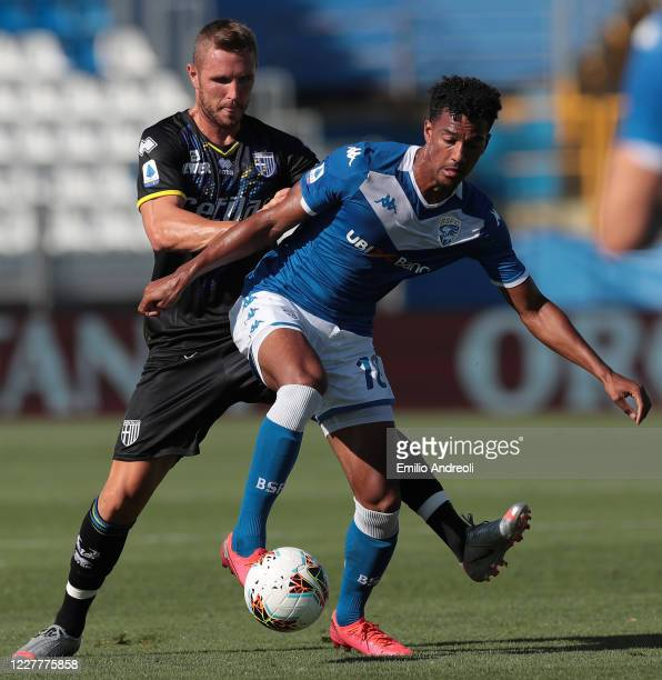 Florian Aye of Brescia Calcio is challenged by Jasmin Kurtic of Parma Calcio during the Serie A match between Brescia Calcio and Parma Calcio at...
