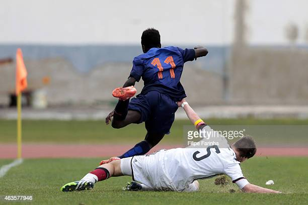 Florian Baak of Germany tackles Bobby Adekanye of Netherlands during the U16 UEFA development tournament between Germany and Netherlands on February...