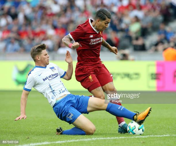 Florian Baak of Hertha and Roberto Firmino of Liverpool battle for the ball during the Preseason Friendly match between Hertha BSC and FC Liverpool...