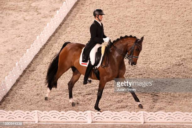 Florian Bacher of Team Austria riding Fidertraum competes in the Dressage Individual Grand Prix Qualifier on day two of the Tokyo 2020 Olympic Games...