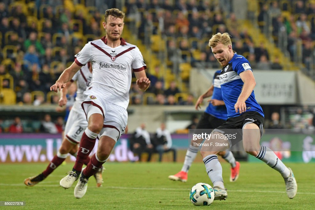 Florian Ballas (L) of Dresden and Andreas Voglsammer of Bielefeld fight for the ball during the Second Bundesliga match between SG Dynamo Dresden and DSC Arminia Bielefeld at DDV-Stadion on September 20, 2017 in Dresden, Germany.