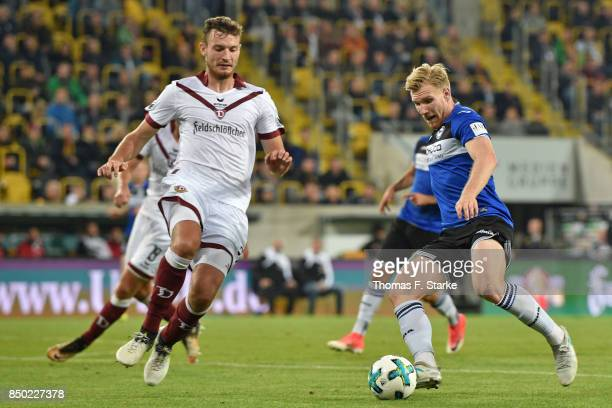 Florian Ballas of Dresden and Andreas Voglsammer of Bielefeld fight for the ball during the Second Bundesliga match between SG Dynamo Dresden and DSC...