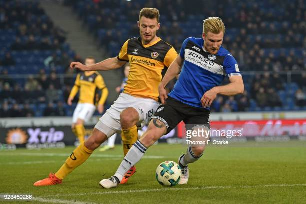 Florian Ballas of Dresden and Andreas Voglsammer of Bielefeld fight for the ball during the Second Bundesliga match between DSC Arminia Bielefeld and...
