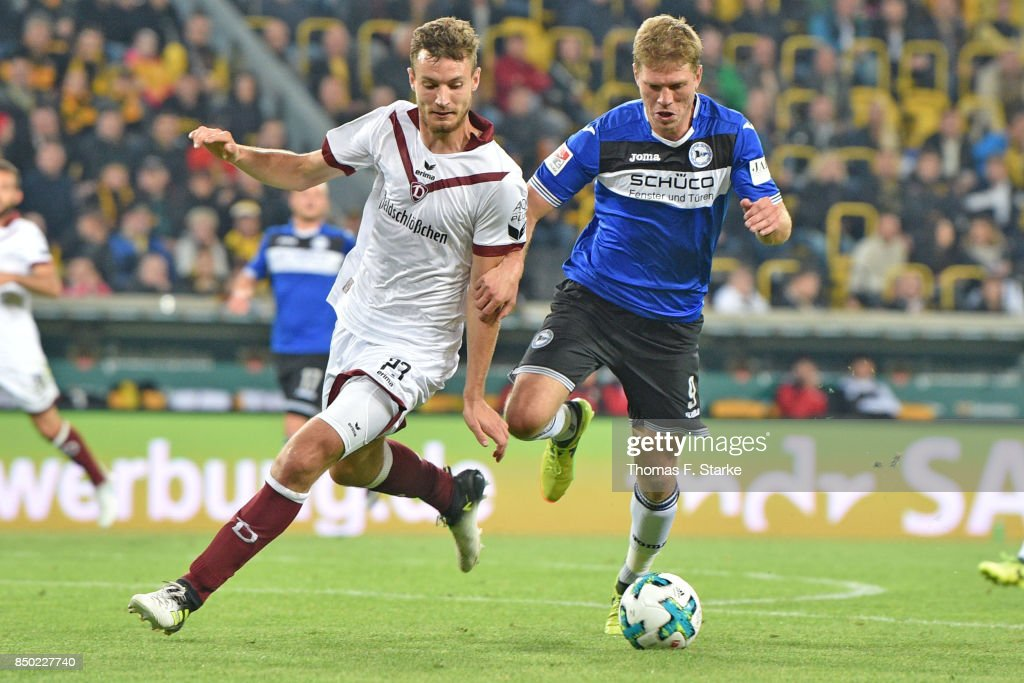 Florian Ballas (L) of Dresden and Fabian Klos of Bielefeld fight for the ball during the Second Bundesliga match between SG Dynamo Dresden and DSC Arminia Bielefeld at DDV-Stadion on September 20, 2017 in Dresden, Germany.