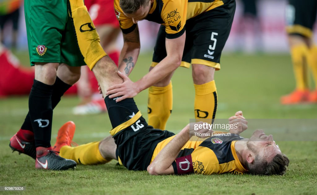 Florian Ballas of Dresden injured on the ground during the Second Bundesliga match between SG Dynamo Dresden and 1. FC Heidenheim 1846 at DDV-Stadion on March 9, 2018 in Dresden, Germany.