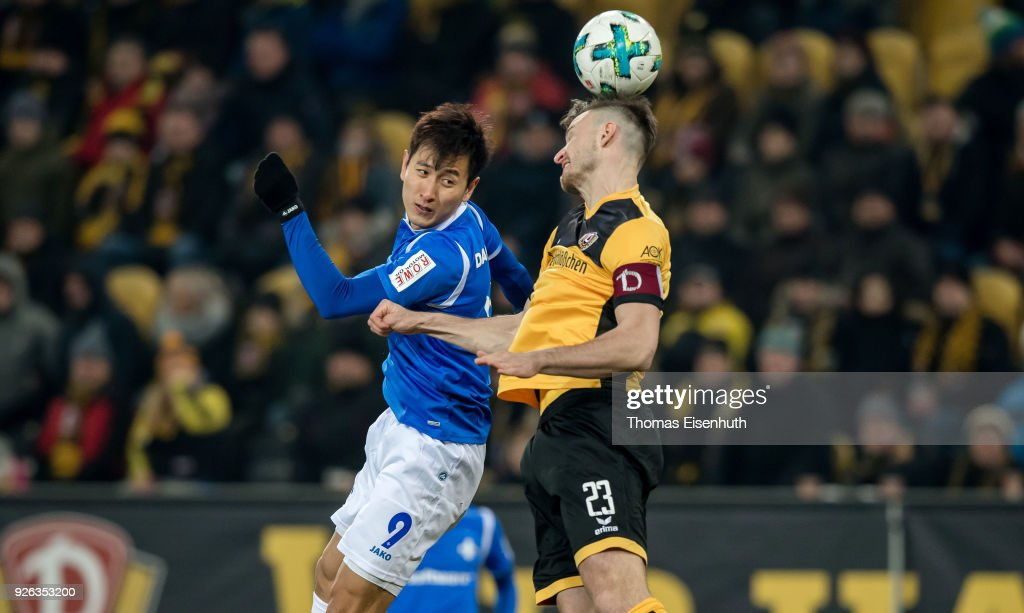 Florian Ballas (R) of Dresden is challenged by Ji Dong-won of Darmstadt during the Second Bundesliga match between SG Dynamo Dresden and SV Darmstadt 98 at DDV-Stadion on March 2, 2018 in Dresden, Germany.