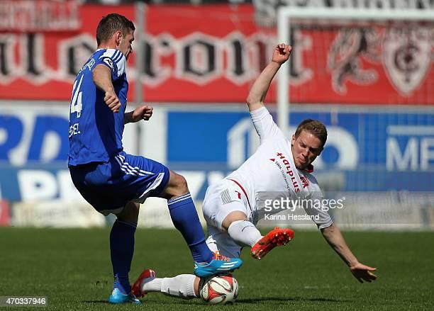 Florian Bruegmann of Halle challenges Maik Kegel of Kiel during the Third League match between Hallescher FC and Kieler SV Holstein at Erdgas...