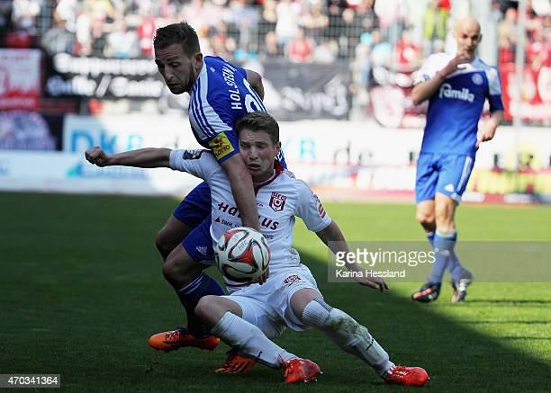 Florian Bruegmann of Halle is challenged by Maik Kegel of Kiel during the Third League match between Hallescher FC and Kieler SV Holstein at Erdgas...