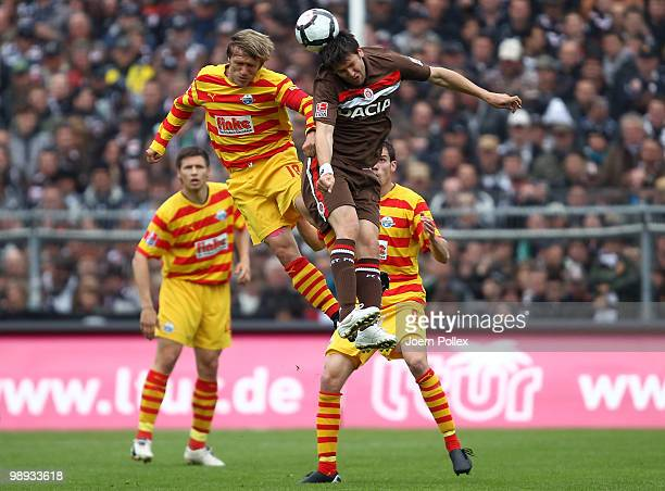 Florian Bruns of St. Pauli and Markus Kroesche of Paderborn battle for the ball during the Second Bundesliga match between FC St. Pauli and SC...