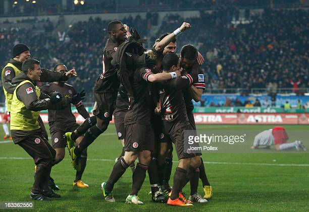 Florian Bruns of St. Pauli celebrates with his team mates after scoring his team's third goal during the Second Bundesliga match between FC St. Pauli...