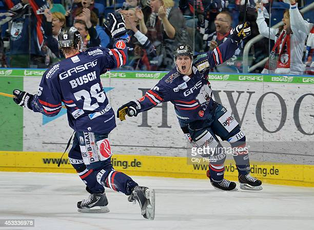 Florian Busch and Shawn Lalonde during a DEL game between Eisbären Berlin and Kölner Haie on december 10, 2013 in Berlin, Germany.