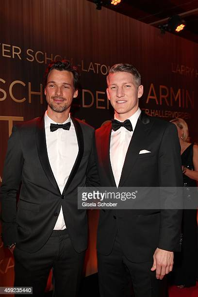 Florian David Fitz and Bastian Schweinsteiger arrive at the Bambi Awards 2014 on November 13 2014 in Berlin Germany