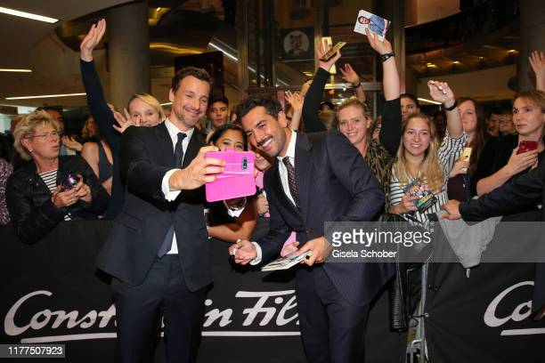 Florian David Fitz and Elyas M'Barek take a selfie with fans during the premiere of Das perfekte Geheimnis at Mathaeser Filmpalast on October 21 2019...