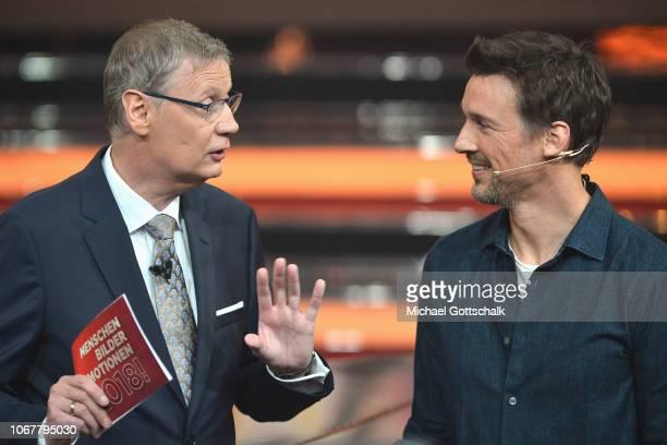 Florian David Fitz and Günther Jauch speak on stage during the tv show '2018 Menschen Bilder Emotionen' on December 3 2017 in Cologne Germany