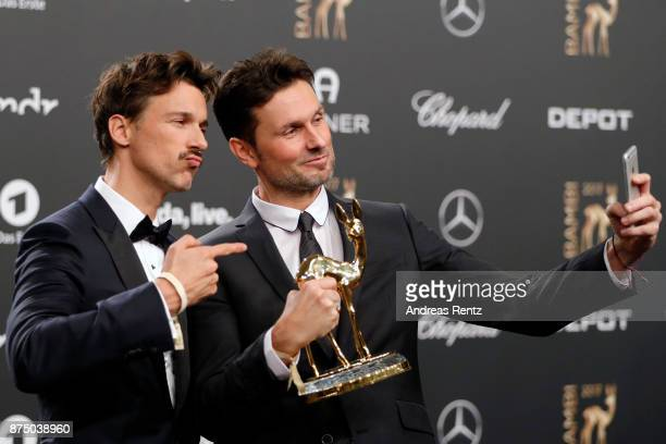 Florian David Fitz and Simon Verhoeven pose with award at the Bambi Awards 2017 winners board at Stage Theater on November 16 2017 in Berlin Germany
