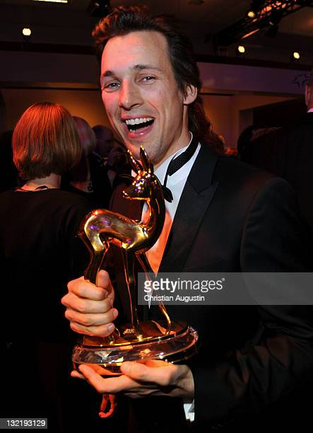 Florian David Fitz holds his award at the Bambi Award 2011 aftershow party at the RheinMainHallen on November 10 2011 in Wiesbaden Germany