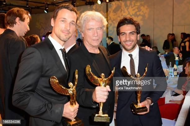 Florian David Fitz Juergen Prochnow and Elyas M'Barek present their awards at the 'Jupiter Award 2013' at Cafe Moskau on April 11 2013 in Berlin...