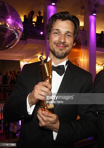 Florian David Fitz poses with his award at the after show party to the 'Lola German Film Award 2011' at Friedrichstadtpalast on April 8 2011 in...