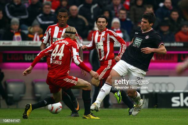 Florian Dick of Kaiserslautern battles for the ball with Anatoliy Tymoshchuk of Muenchen and his team mates Danijel Pranjic and Luiz Gustavo during...