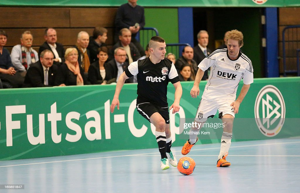 Florian Dondorf (R) of Muenster battles for the ball with Carlos Rafael Ferreira Monteiro (L) of Hamburg during the DFB Futsal Cup final match between Hamburg Panthers and UFC Muenster at Sporthalle Wandsbek on April 6, 2013 in Hamburg, Germany.