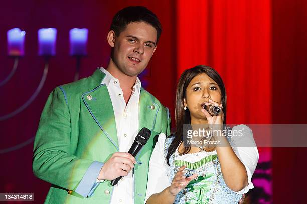 Florian Fesl and Belsy Demetz perform on stage during the 'Alpenlaendische Weihnacht' Show at the Goebel's Hotel Arena on November 30 2011 in...